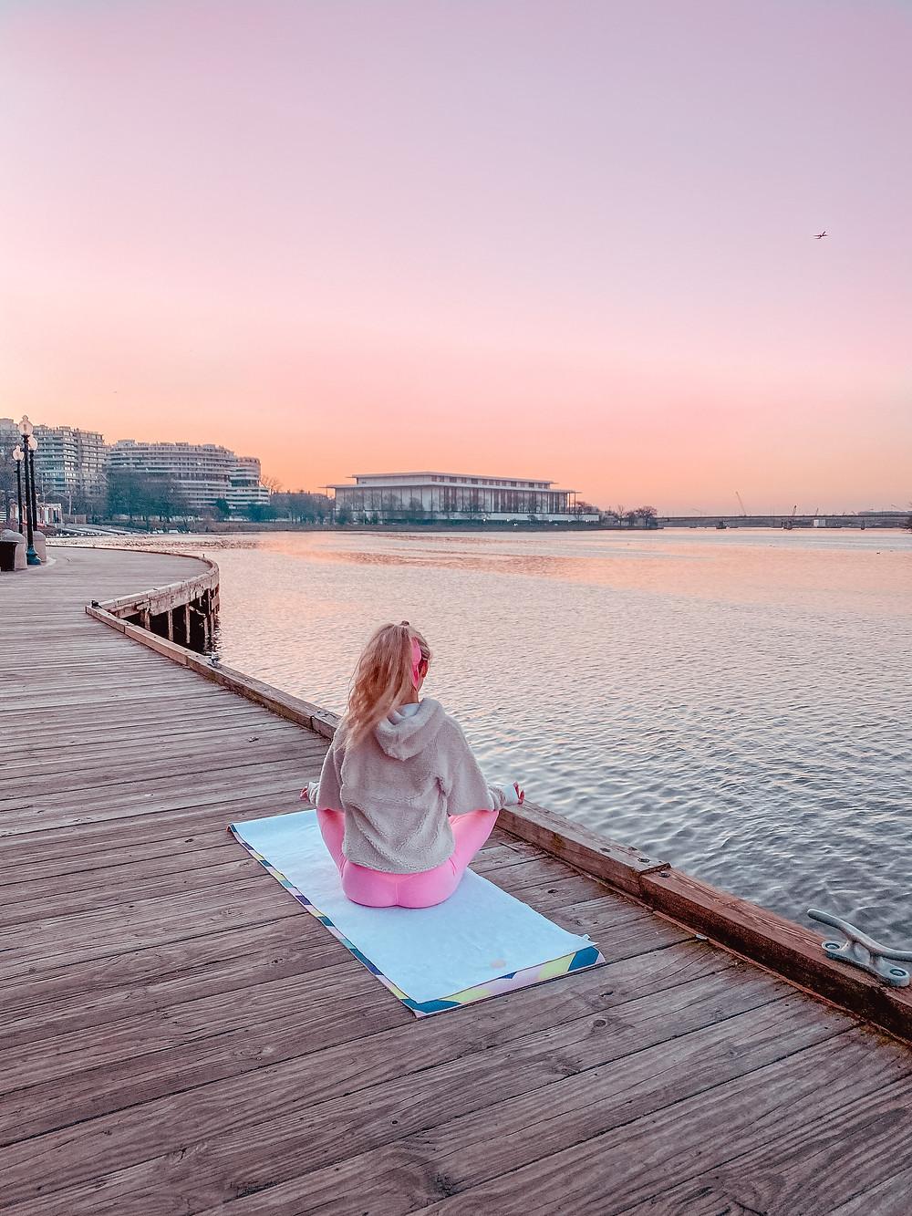 Georgetown waterfront sunrise girl meditating yoga