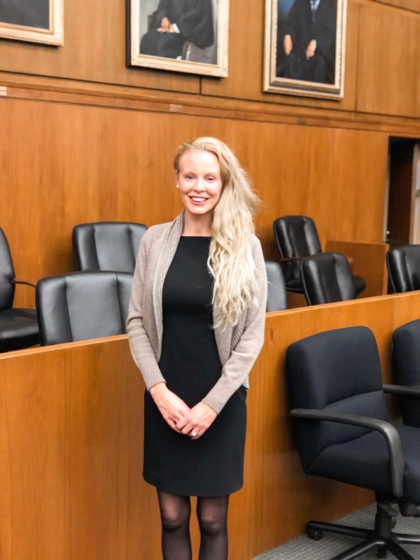 blonde woman in court room