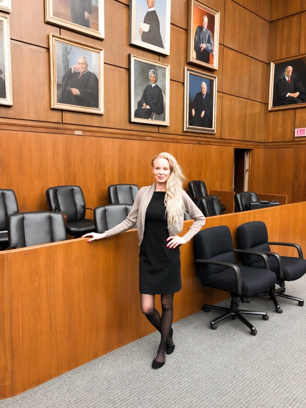 blonde woman in court room naturalization