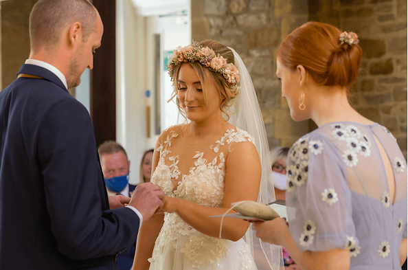 Bride and groom exchanging rings, as Meg guides them through their words, at humanist wedding ceremony