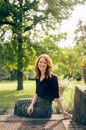 Meg Senior, celebrant, sitting in Botanical Gardens wedding venue in Sheffield