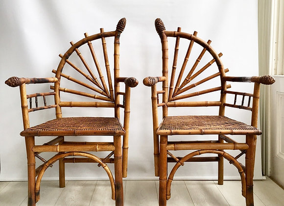 A pair of decorative bamboo chairs