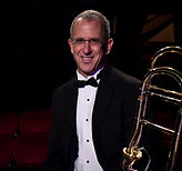Bruce Alpern rejoined the Sheldon Theatre Brass Band in 2004, having also played with us from 1992-97. He served as a musician in the Army for ten years and in National Guard for thirteen years, retiring last September. Bruce has been a mailman since 1992. He also plays with the Minnesota Jazz Orchestra.