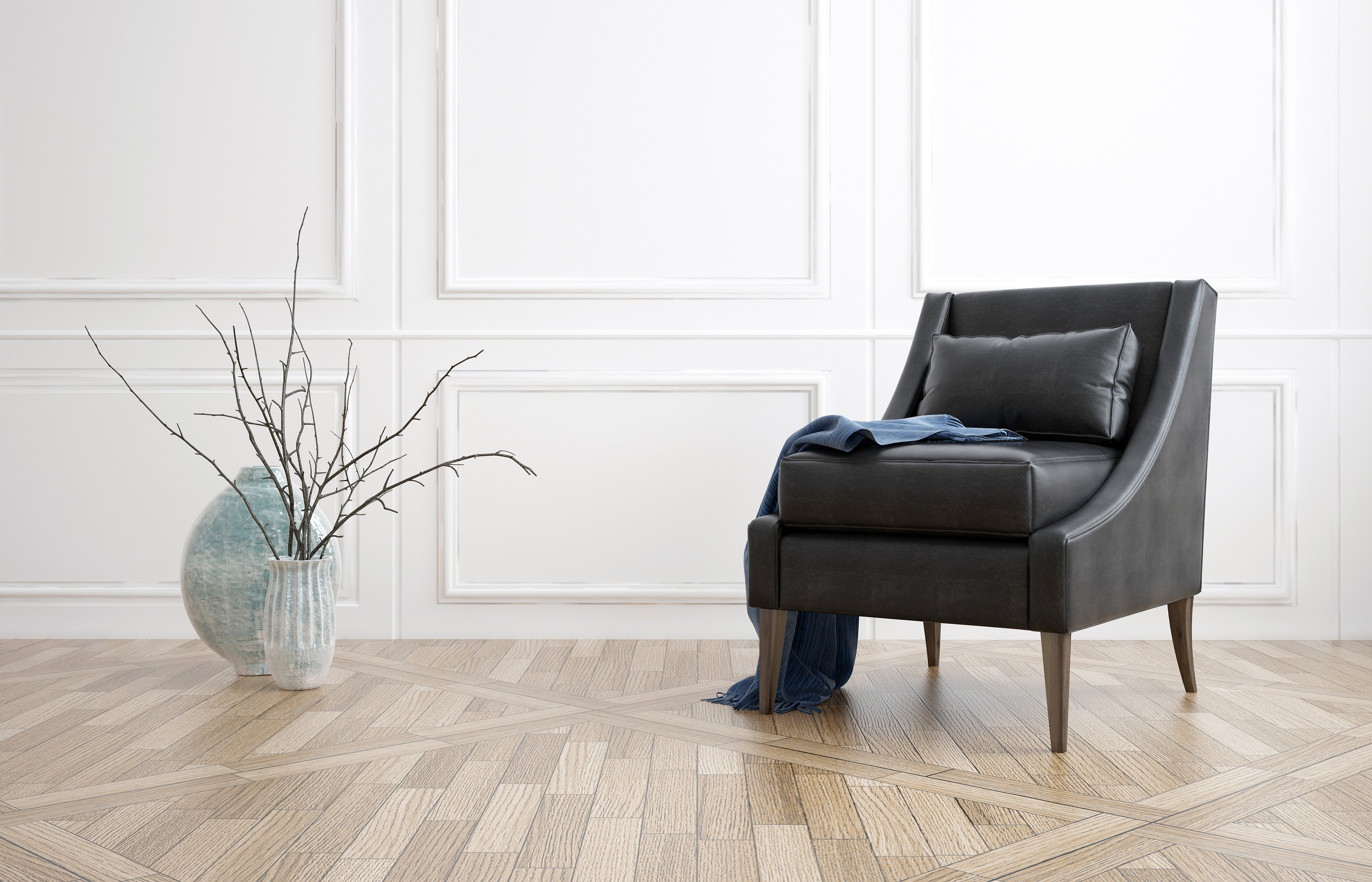 Comfortable black leather armchair in a minimalist living room interior with white panelled walls, h