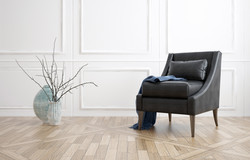 Comfortable black leather armchair in a minimalist living room interior