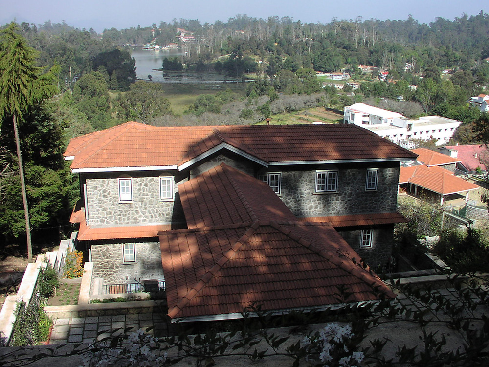 A House designed by us in Kodaikanal concerning the slope and the view.