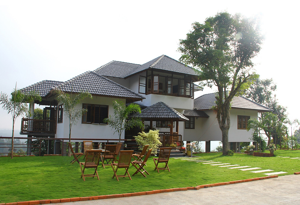 Vacation house designed by us for a residence at Wayanad based on the site and to suit the needs.