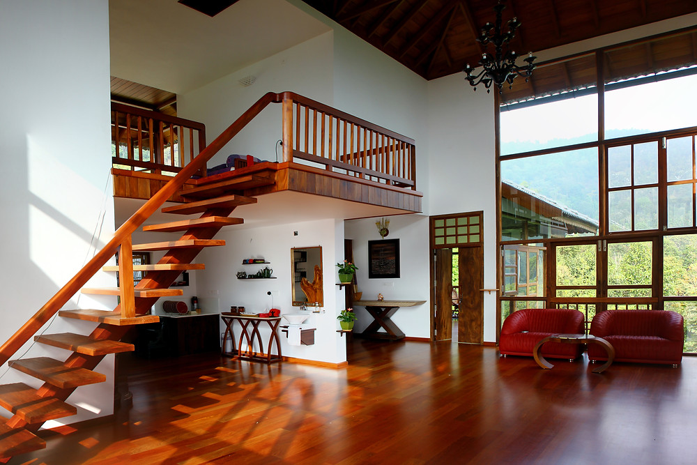 Wayanad House designed by Benny Kuriakose having timber roof, ceiling and floor.