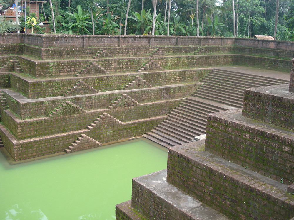 Temple tank in Peralassery Temple in Kannur. The district built with laterite blocks.