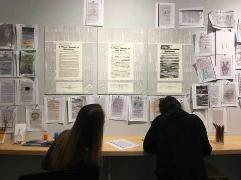 Participants creating cross-out poems at the Holter Museum of Art