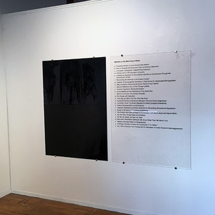 """Meditate on the Blank Space Below, diptych, installation view, black and clear plexi with vinyl text, 40"""" H x 36"""" W per panel (2017)"""