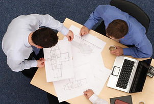 Photo of technicians designing a network using a floorplan
