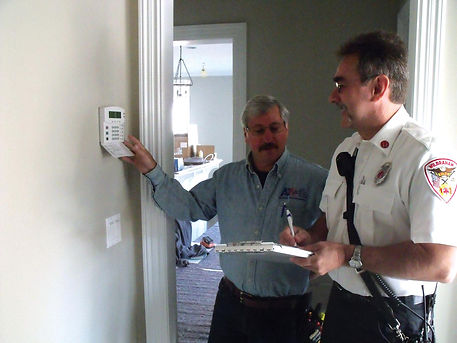 Photo of our fire system being inspected by the fire chief