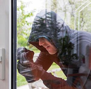 Photo of a burglar picking a lock
