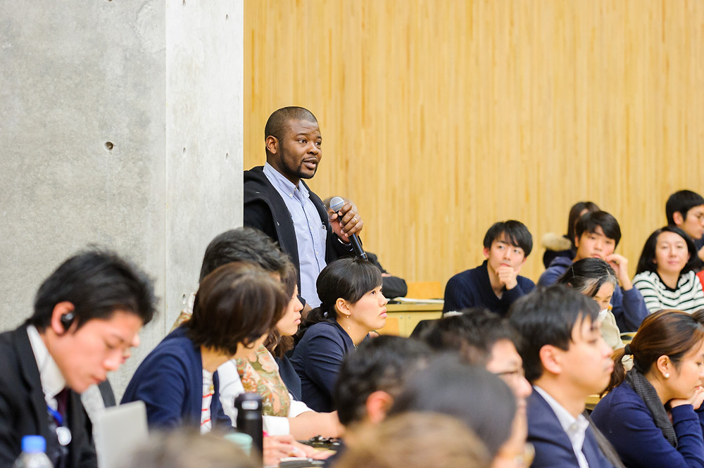 "A participant asking questions at Public Forum at the University of Tokyo  December 14, 2017 - Tokyo, Japan. World Bank Group President Jim Yong Kim speaks at the public forum ""Disrupting Development through Science, Technology and Innovation"" at the University of Tokyo. As part of the UHC Forum, the event is co-organized by World Bank Group and the University of Tokyo to discuss how the appropriate use of STI (Science, Technology and Innovation) can accelerate progress towards the achievement of the Sustainable Development Goals (SDGs) and the World Bank Group twin goals to end extreme poverty by 2030 and promote shared prosperity. #HealthforAll #UHCForum Photo: Antony Tran / World Bank"