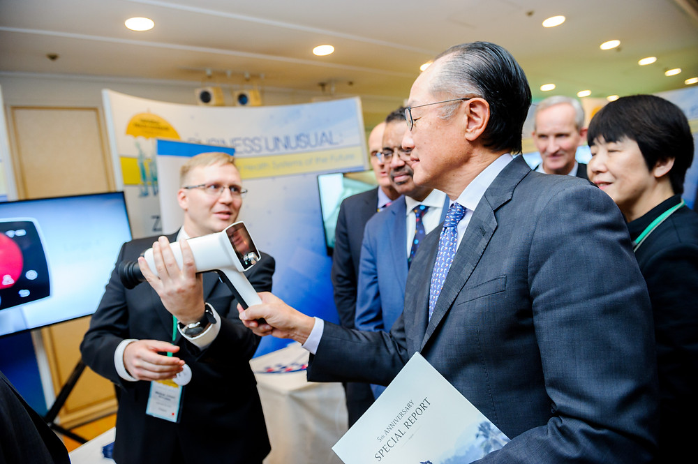 "World Bank Group President Jim Yong Kim visits the Innovation Showcase during the UHC Forum  December 14, 2017 - Tokyo, Japan. World Bank Group President, Jim Yong Kim visits the Innovation Showcase titled ""Business Unusual: Innovating for Health Systems of the Future"" during the UHC Forum. Around the world, ingenious practitioners and passionate changemakers are making huge strides to accelerate progress towards UHC through innovation. As part of the UHC Forum, the event highlights such innovations at an all-day showcase which features over 25 organizations presenting a set of more than 40 innovations relevant to accelerating progress towards UHC, including in low-resource settings. #HealthforAll #UHCForum Photo: Antony Tran / World Bank"