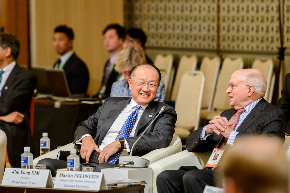 "World Bank Group President Jim Yong Kim discussing with Martin Feldstein from the Harvard University.  May 20, 2016 - Sendai, Japan. Finance ministers and central bank governors from G7 member states gather in Sendai in advance of the G7 Ise-Shima Summit to discuss issues such as economic growth. World Bank Group President Jim Yong Kim discussing with Martin Feldstein, Harvard University George F Baker Professor of Economics at the G7 High-Level Symposium ""Future of the Global Economy"". Photo: Antony Tran / World Bank"