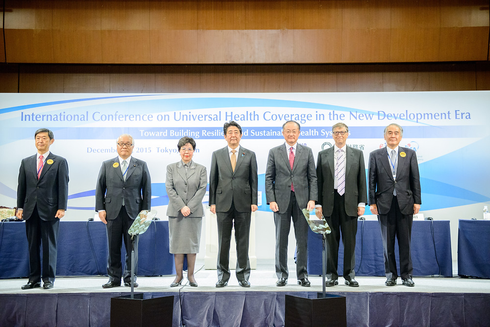 "World Bank Group President Jim Yong Kim at the International Conference on Universal Health Coverage  December 16, 2015 - Tokyo, Japan. At the International Conference on ""Universal Health Coverage in the New Development Era: Toward Building Resilient and Sustainable Health Systems"".    From Left, Shinichi Kitaoka, President, Japan International Cooperation Agency (JICA); Keizo Takemi, Member, House of Councillors, Japan; Margaret Chan, Director-General, World Health Organization (WHO); Shinzo Abe, Prime Minister of Japan; Jim Yong Kim, World Bank Group President; Bill Gates, Co-chair, Bill & Melinda Gates Foundation, U.S.A.; Akio Okawara, President and CEO, Japan Center for International Exchange (JCIE) Photo: Antony Tran / World Bank"