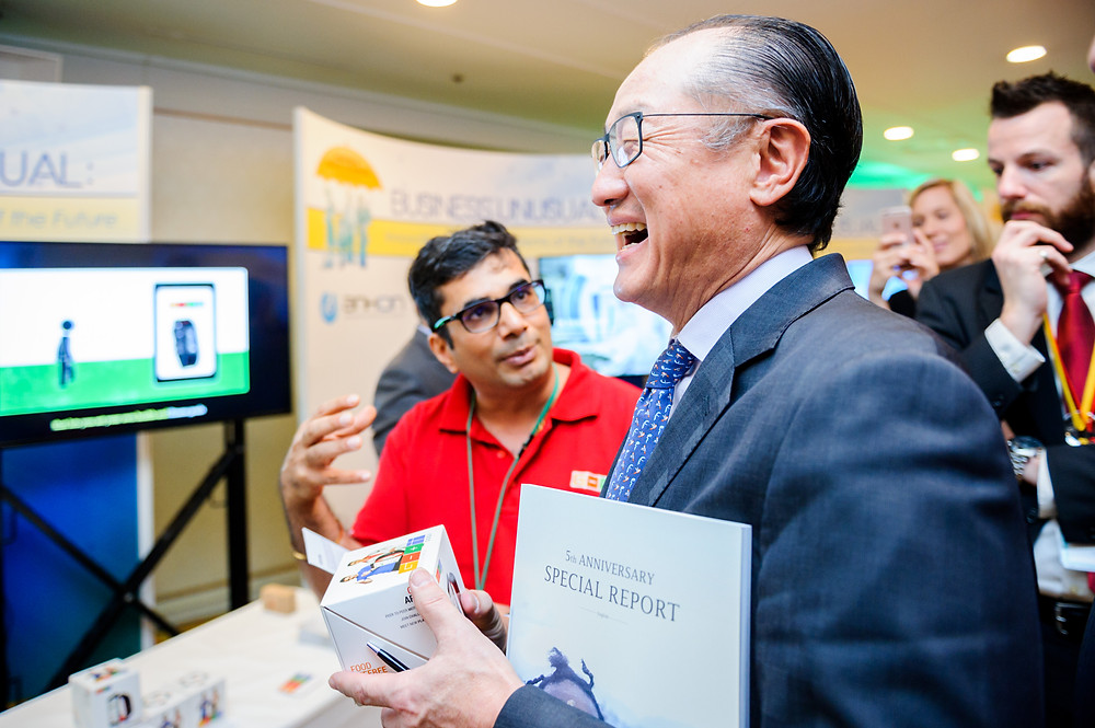 """World Bank Group President Jim Yong Kim visits the Innovation Showcase during the UHC Forum  December 14, 2017 - Tokyo, Japan. World Bank Group President, Jim Yong Kim visits the Innovation Showcase titled """"Business Unusual: Innovating for Health Systems of the Future"""" during the UHC Forum. Around the world, ingenious practitioners and passionate changemakers are making huge strides to accelerate progress towards UHC through innovation. As part of the UHC Forum, the event highlights such innovations at an all-day showcase which features over 25 organizations presenting a set of more than 40 innovations relevant to accelerating progress towards UHC, including in low-resource settings. #HealthforAll #UHCForum Photo: Antony Tran / World Bank"""