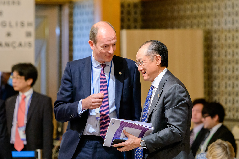 "World Bank Group President Jim Yong Kim discussing with Mark Bowman, Director General, Humanitarian, Security, Conflict and International Finance at the Department for International Development.  May 20, 2016 - Sendai, Japan. Finance ministers and central bank governors from G7 member states gather in Sendai to discuss issues such as economic growth in advance of the G7 Ise-Shima Summit. World Bank Group President Jim Yong Kim discussing with Mark Bowman, Director General, Humanitarian, Security, Conflict and International Finance, Department for International Development at the G7 High-Level Symposium ""Future of the Global Economy"". Photo: Antony Tran / World Bank"