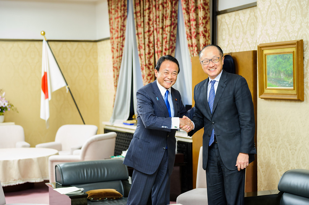 World Bank Group President Jim Yong Kim with Japanese Deputy Prime Minister and Finance Minister Taro Aso  December 14, 2017 - Tokyo, Japan. World Bank Group President Jim Yong Kim meets with Japanese Deputy Prime Minister and Finance Minister Taro Aso and discusses ways to accelerate progress on UHC. Photo: Antony Tran / World Bank