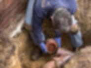 workman fixing drain