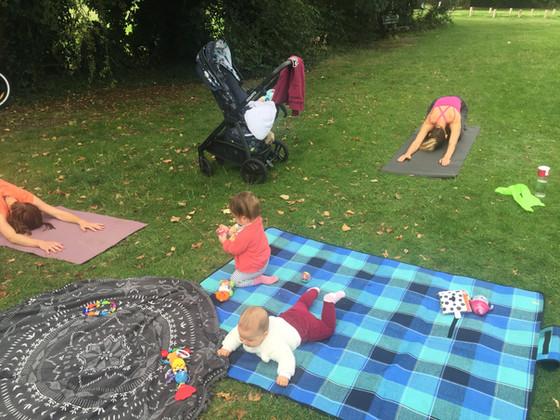 Postnatal Pilates class in a Park