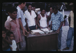 First payment from Trust Fund, 7-4-1957, Photo by Leonard Mason, Robert C. Kiste Collection, UHawaii