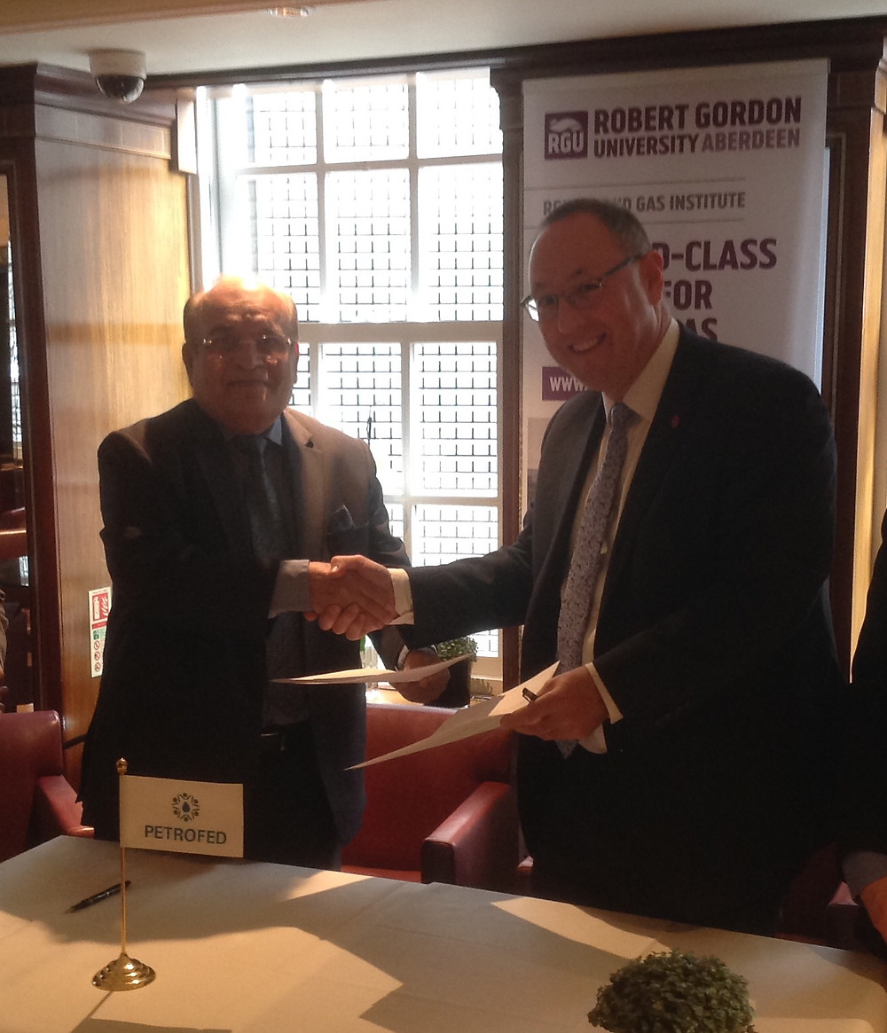 Dr.RK. Malhotra and Prof. Paul signing the MoU