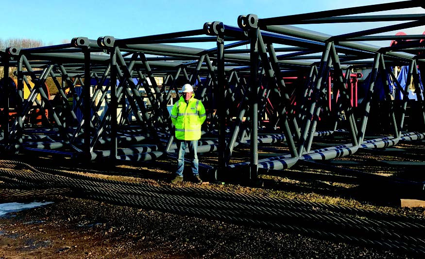 OilMac Managing Director, Alex Fyfe with some of the sections for the 115m main mast.