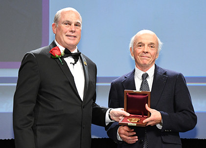 Sam Gray, retired senior researcher with CGG Subsurface Imaging, being presented with the SEG Maurice Ewing Medal by SEG President Bill Abriel