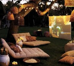 outside movie, outdoor, cushions, lanterns,