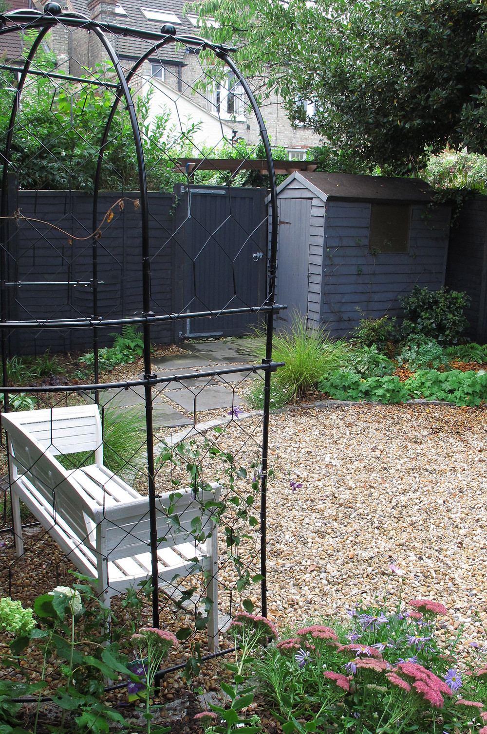 Grey Painted shed and Fence
