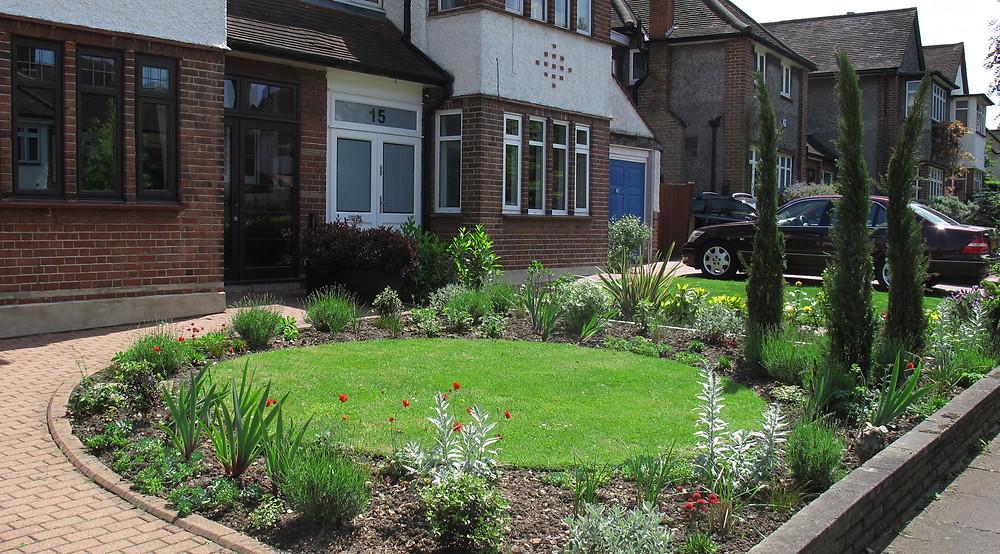 Mediterranean style front garden with lawn