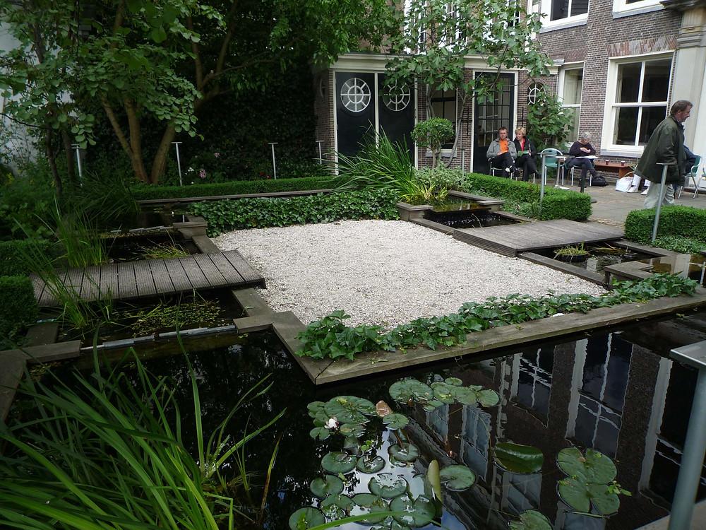 Edging, water feature, canal, garden bridge, water lilies, Amsterdam open gardens, gravel