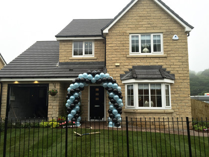 Balloon Arch outside New House