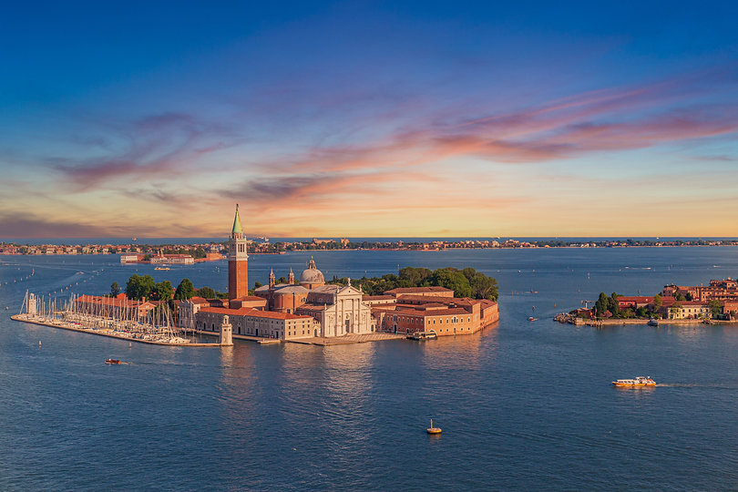 church-san-giorgio-maggiore-surrounded-by-canals-during-sunset-venice-italy.jpeg