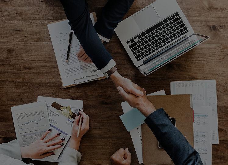 business-people-shaking-hands-together_edited.jpg