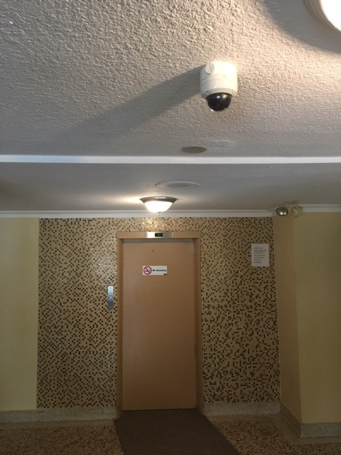 camera installed on main floor ceiling viewing elevator viewing foot traffic
