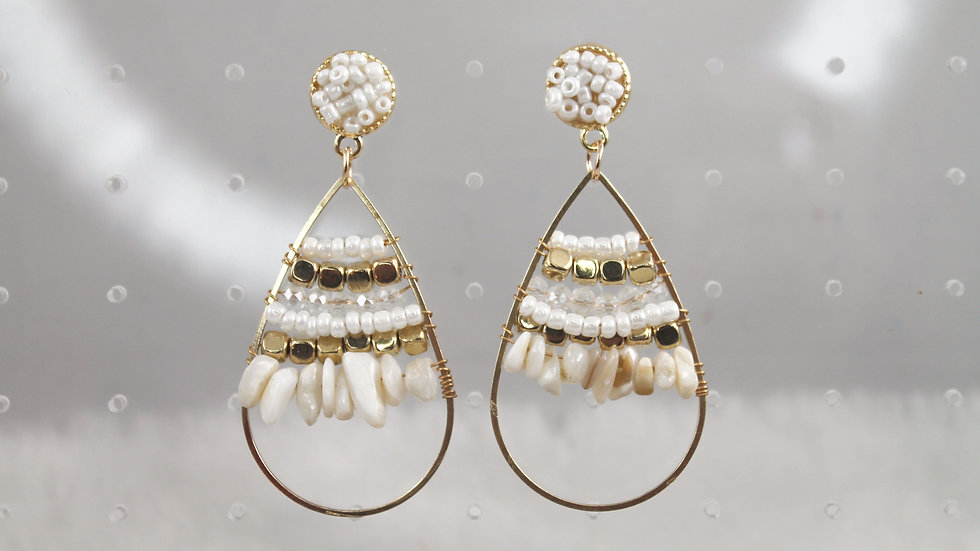 Gold and white beaded earrings.