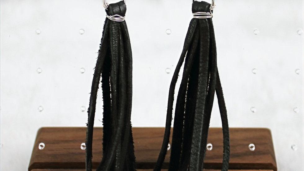 Hand tied tassel earrings with cross stone