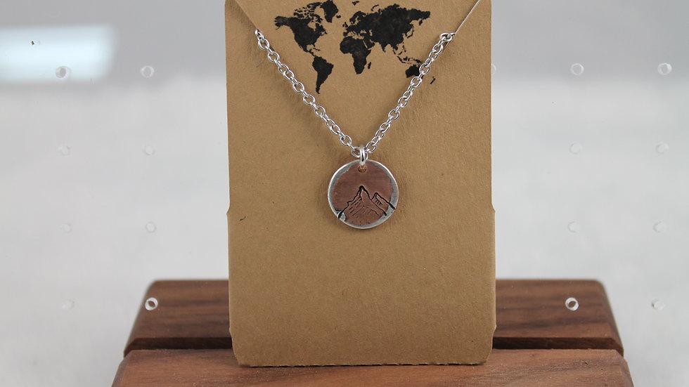 Mixed metal circular pendant with mountain