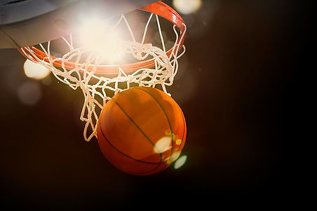 Basketball going through the basket at a