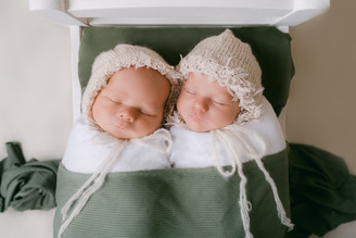 Twin newborns in bed