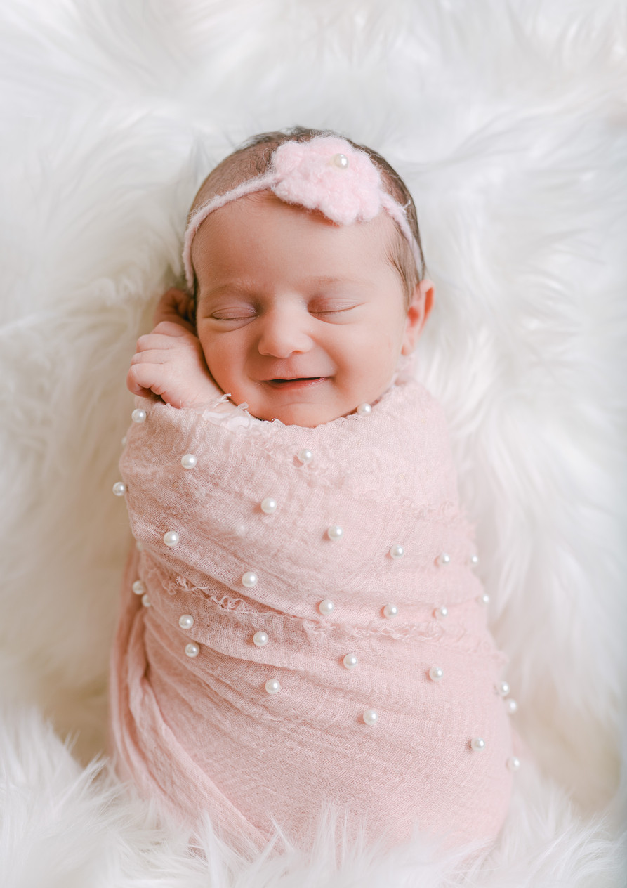 Newborn wrapped smile