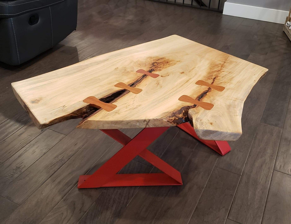 Live Edge Table with Wooden Bowties and Red Metal Legs