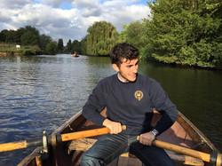 Justin rowing an English boat
