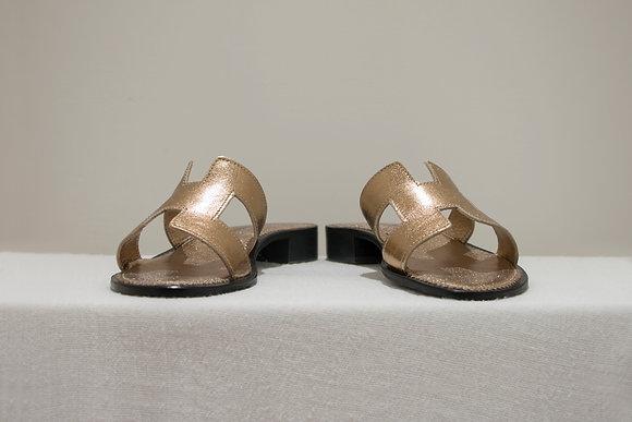 Sandali modello Hermes laminato rame