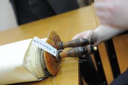 Photo 126 - Lenin Scientific Library - R. Koves Examining Torah with Library Cat