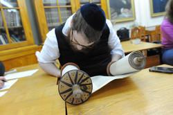 Photo 181 - Lenin Scientific Library - R. Koves Examining Torah with Unique Top
